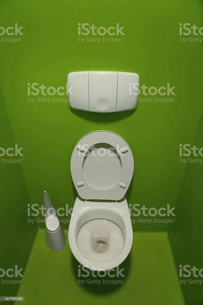 white toilette bowl on background green stock photo
