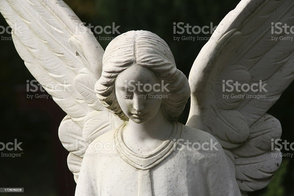 white tombstone angel on a grave stock photo