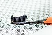 White toothpaste on black toothbrush