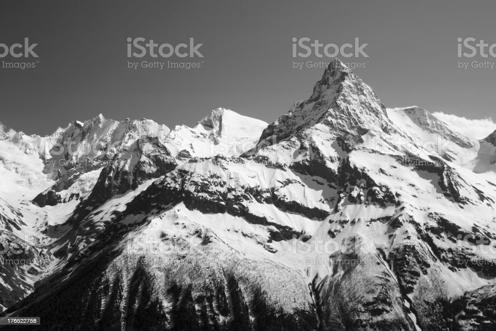 white tops of the mountains in summer royalty-free stock photo