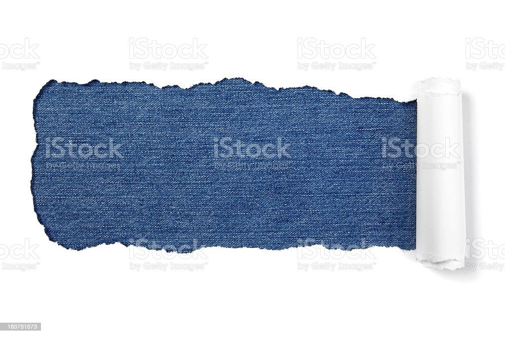 White torn paper on denim background royalty-free stock photo