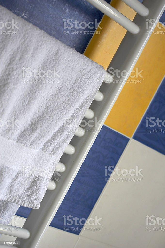 White towel drying on radiator royalty-free stock photo
