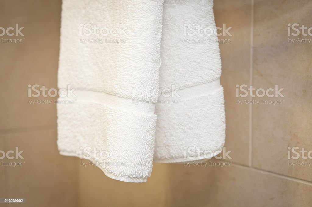 White towel in a hotel bathroom stock photo