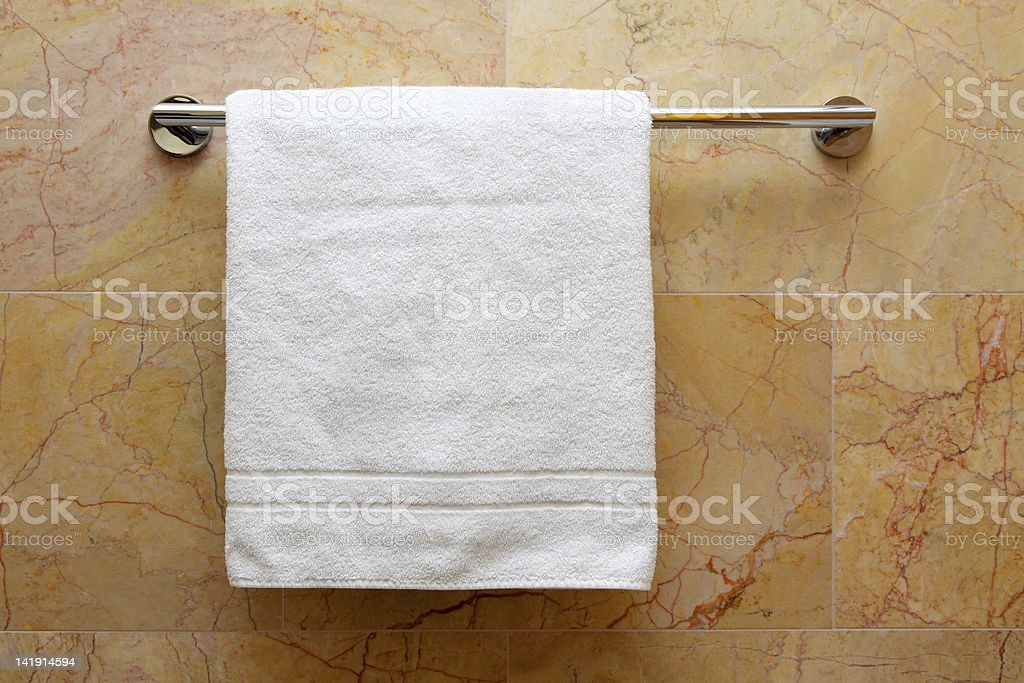 White towel on hanger with marble background stock photo