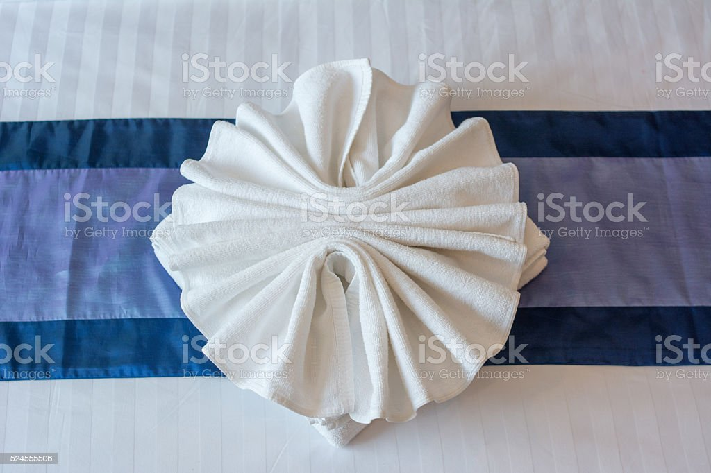 white towels design on bed sheet stock photo