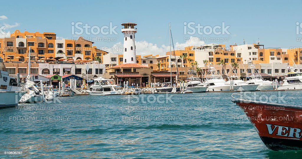 White tower and gold buildings of Cabo San Lucas stock photo