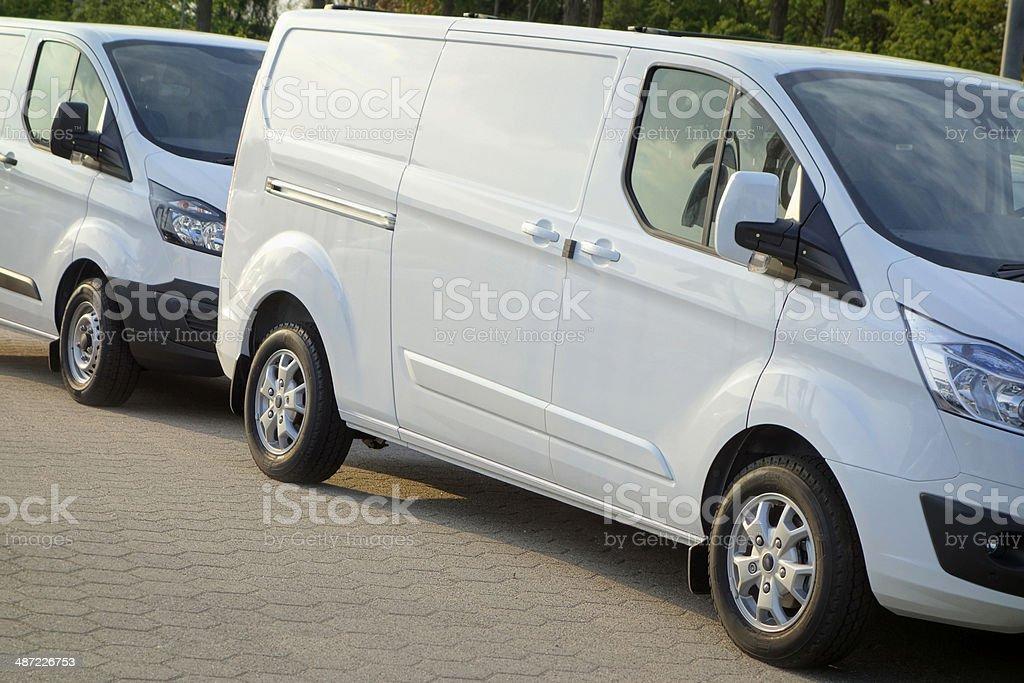 White Tranporters at parking öot royalty-free stock photo