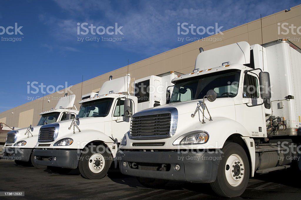 White Transportation Trucks at a Warehouse stock photo
