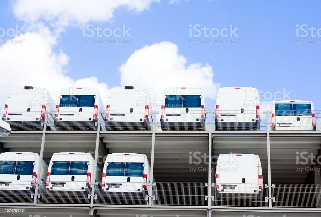 White Transporter at dealership on two floors stock photo