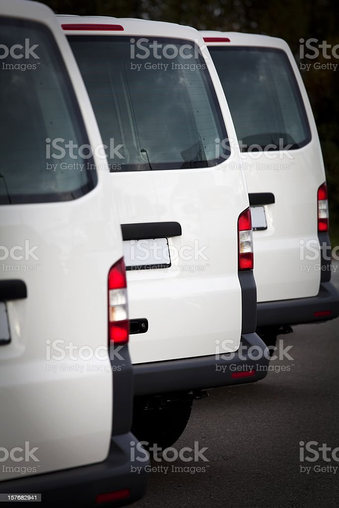 white transporters in a row stock photo