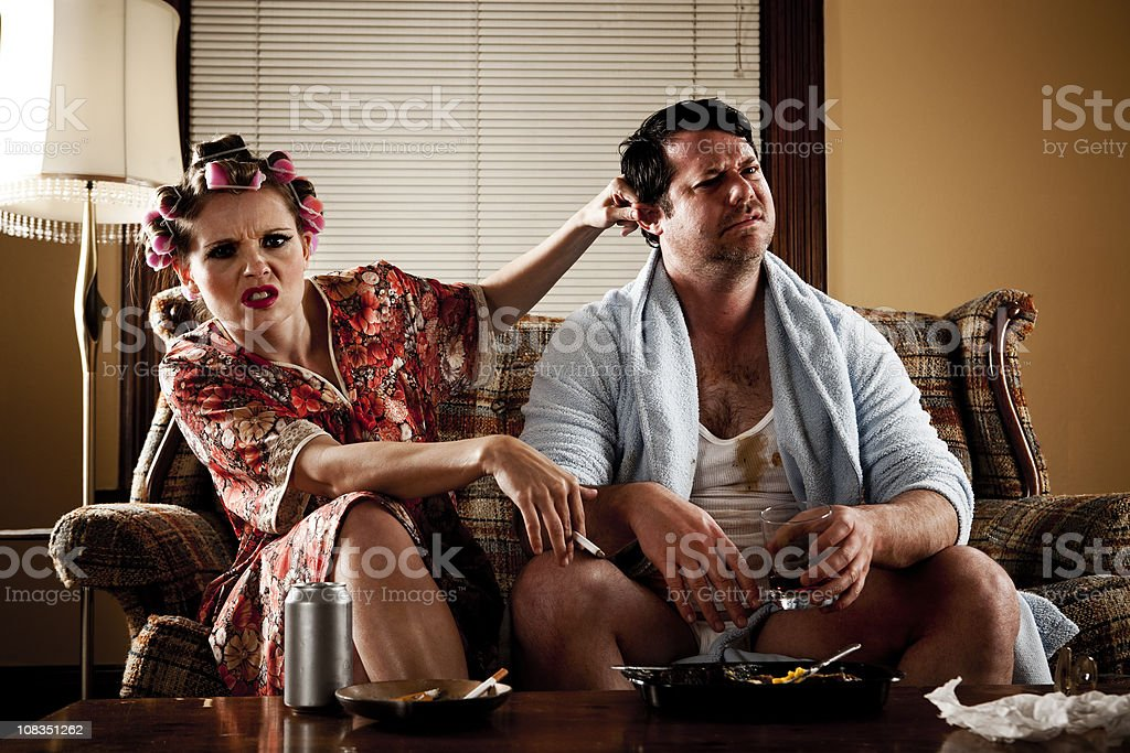 White Trash Series: Couple Sitting on Their Couch stock photo