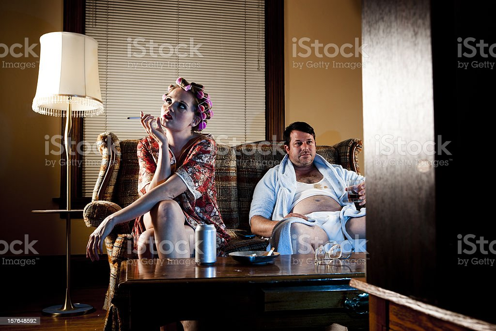 White Trash Series: Couple Sitting on Their Couch royalty-free stock photo