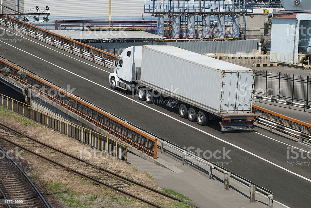 white truck drives near the plant royalty-free stock photo