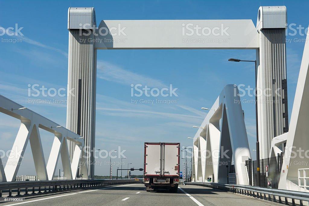 White truck driving on botlek bridge stock photo