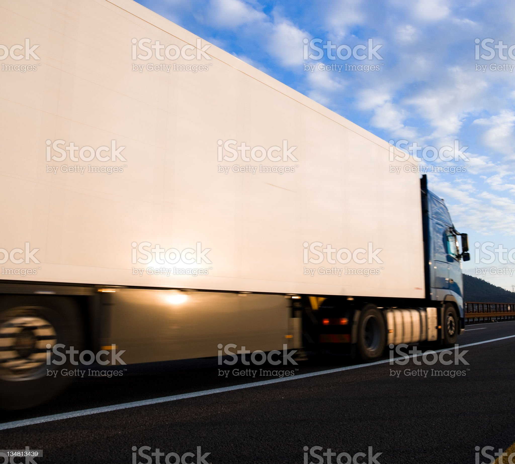 White Truck Driving on The Highway Motion royalty-free stock photo