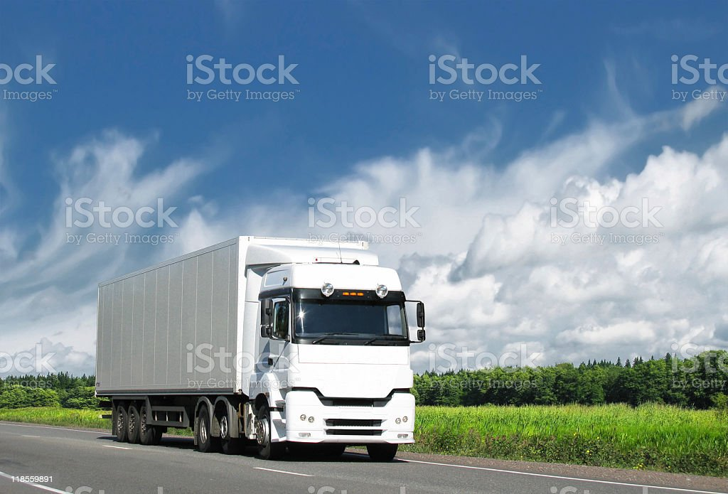 white truck on country highway under blue sky royalty-free stock photo
