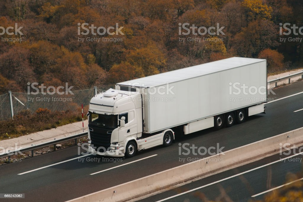 White truck on highway stock photo