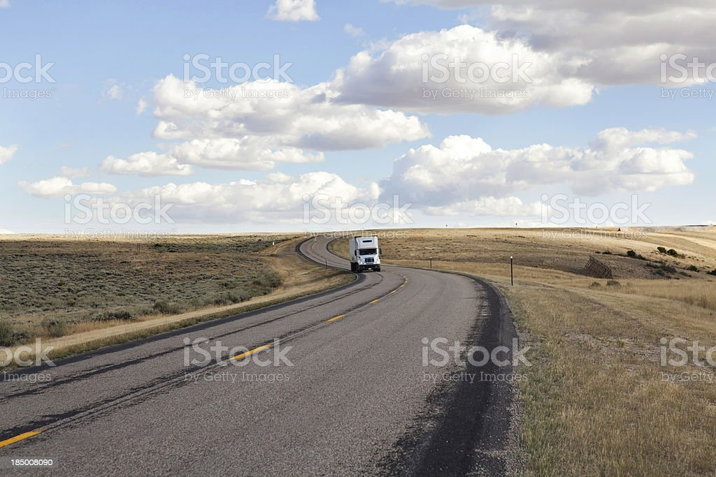 A white truck on the highway in the countryside royalty-free stock photo