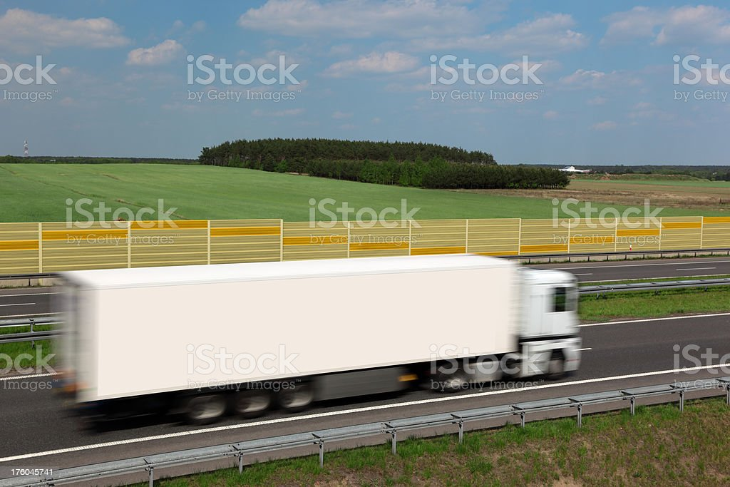 White Truck Speeding On Highway, Horizontal royalty-free stock photo