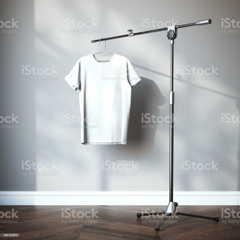 White t-shirt hanging on the tripod. 3d rendering stock photo