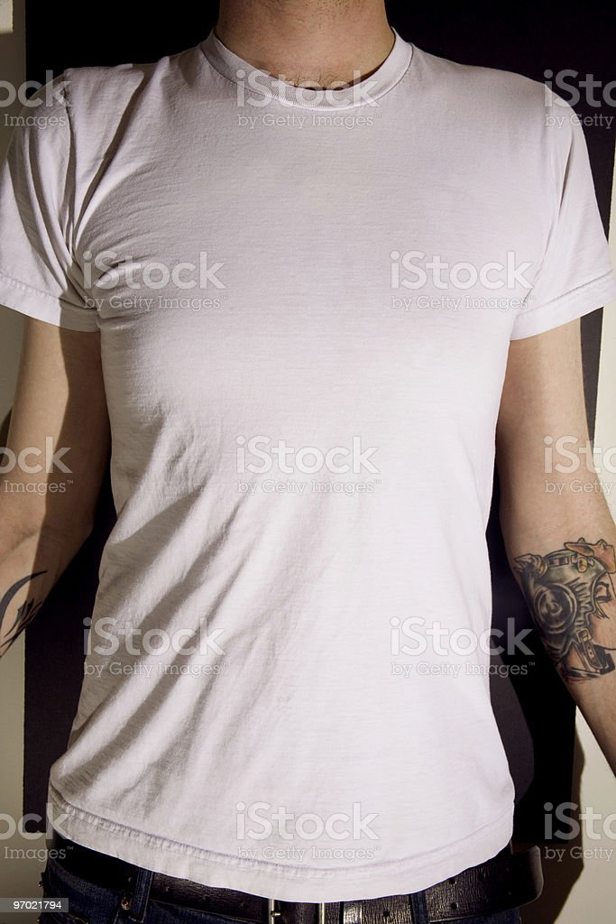 White t-shirt on a young man royalty-free stock photo