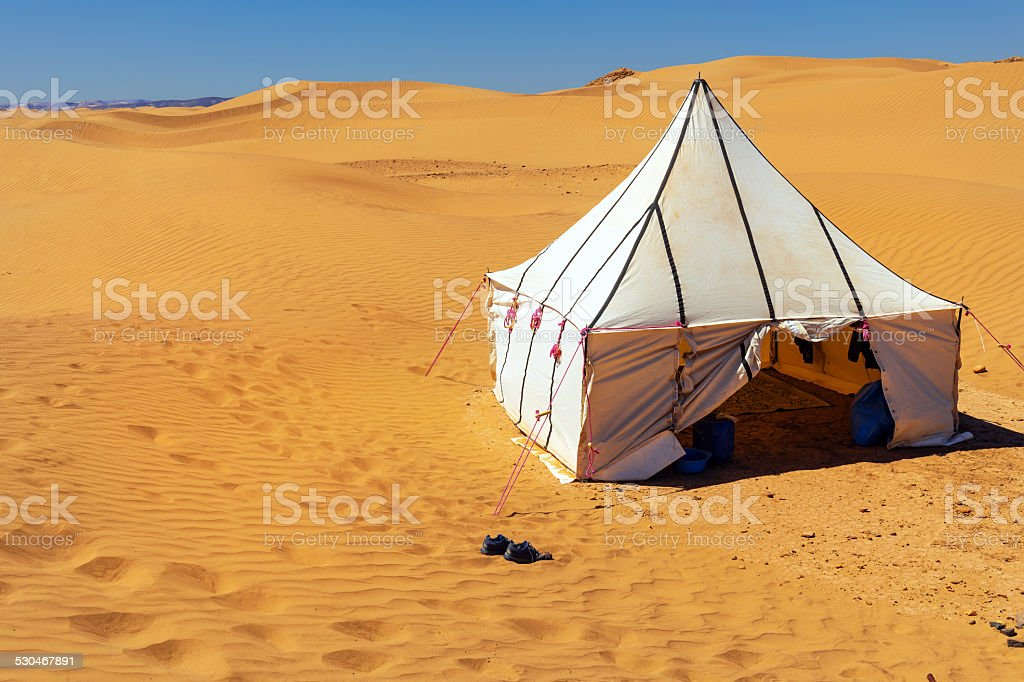 White Tuareg tent in the desert Erg Cheb Morocco Africa stock photo