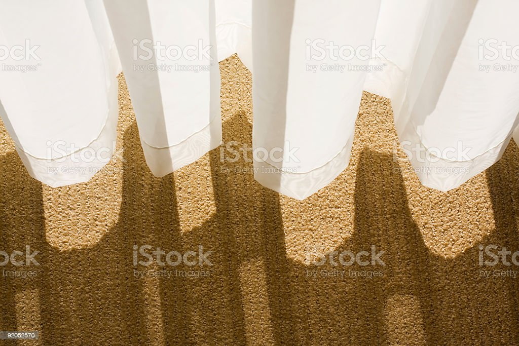 White tulle and brown carpet stock photo