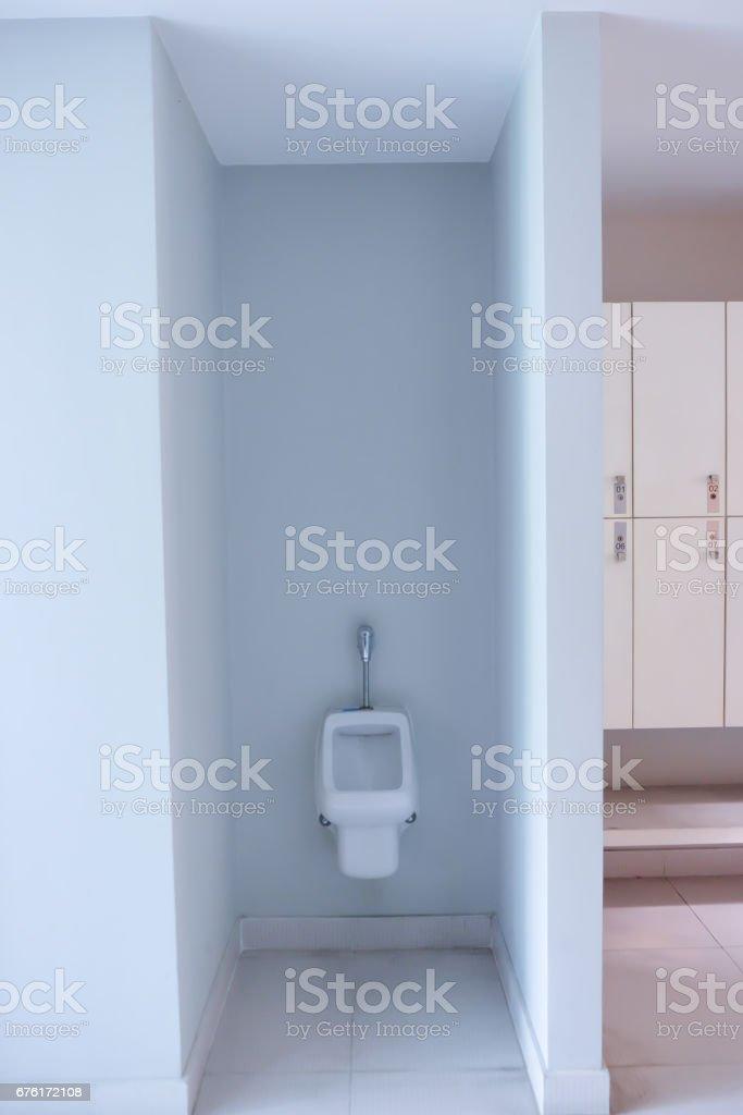 White urinals in clean men public toilet room empty stock photo