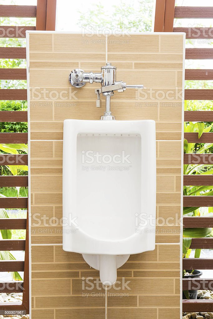 White urinals with ceramic tile on wall. royalty-free stock photo
