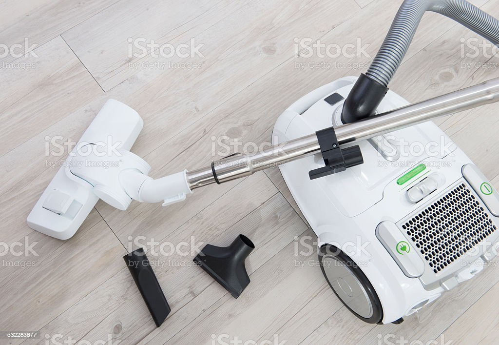White vacuum cleaner with attachments. stock photo