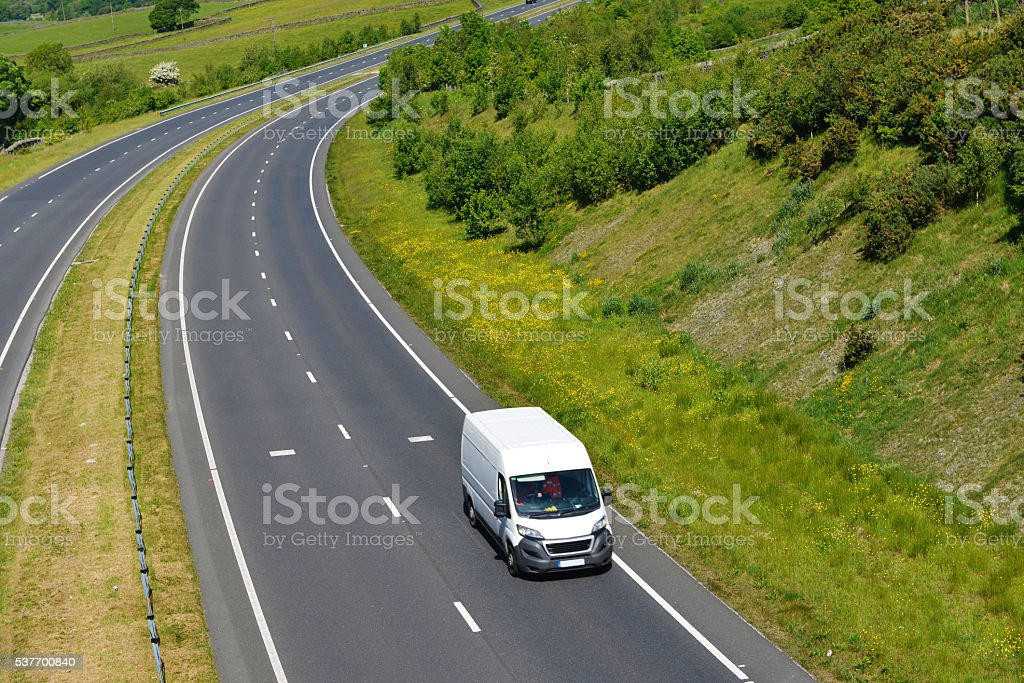 White Van on Open Road. stock photo