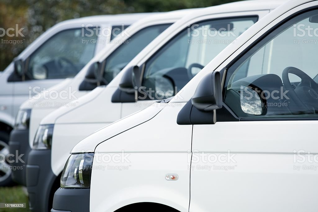White vans in a row royalty-free stock photo