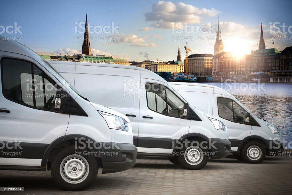 white vans in the city stock photo