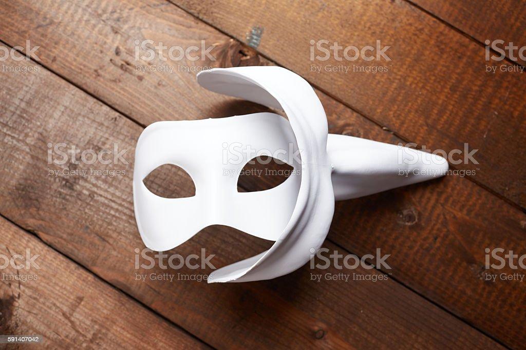White Venetian mask on the table stock photo