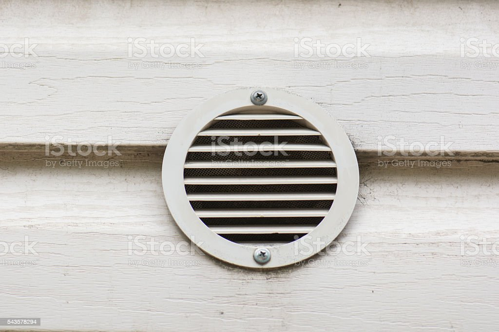 White ventilation opening in a wall stock photo