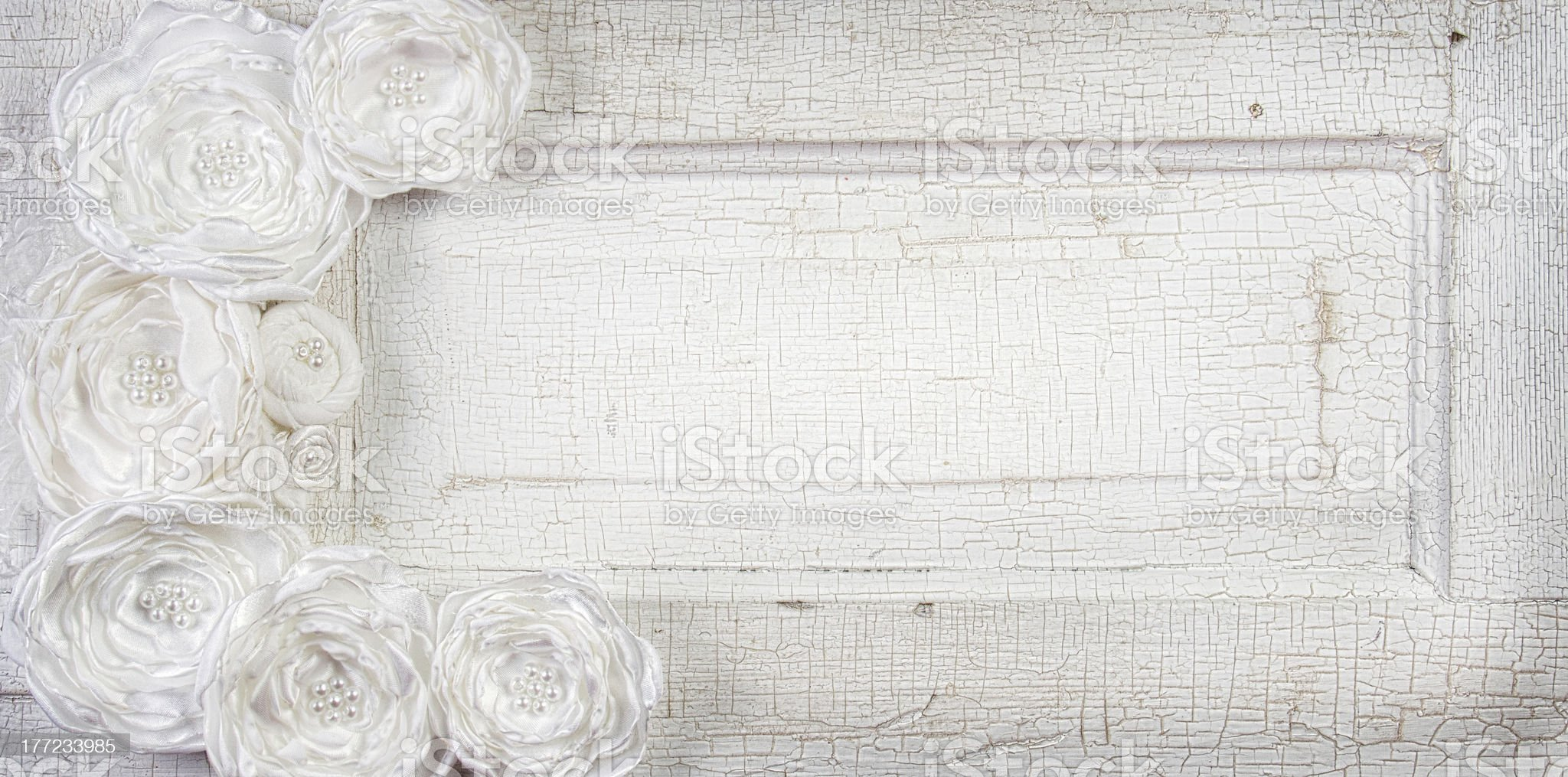 White Vintage flowers on antique door royalty-free stock photo