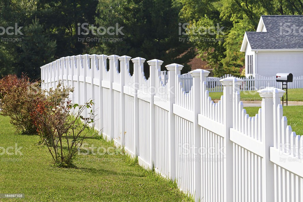 White vinyl fence stock photo