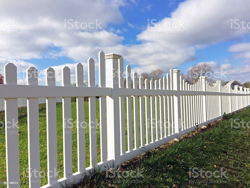 White vinyl fence stock photo