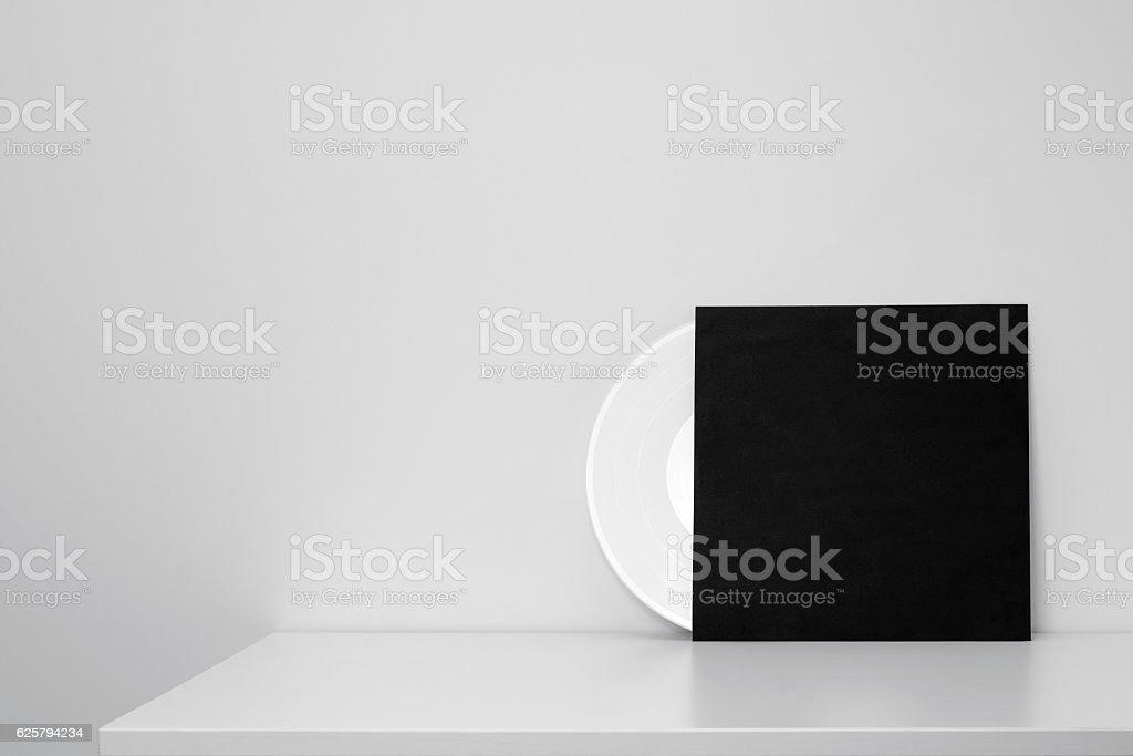 white vinyl record in black paper case stock photo