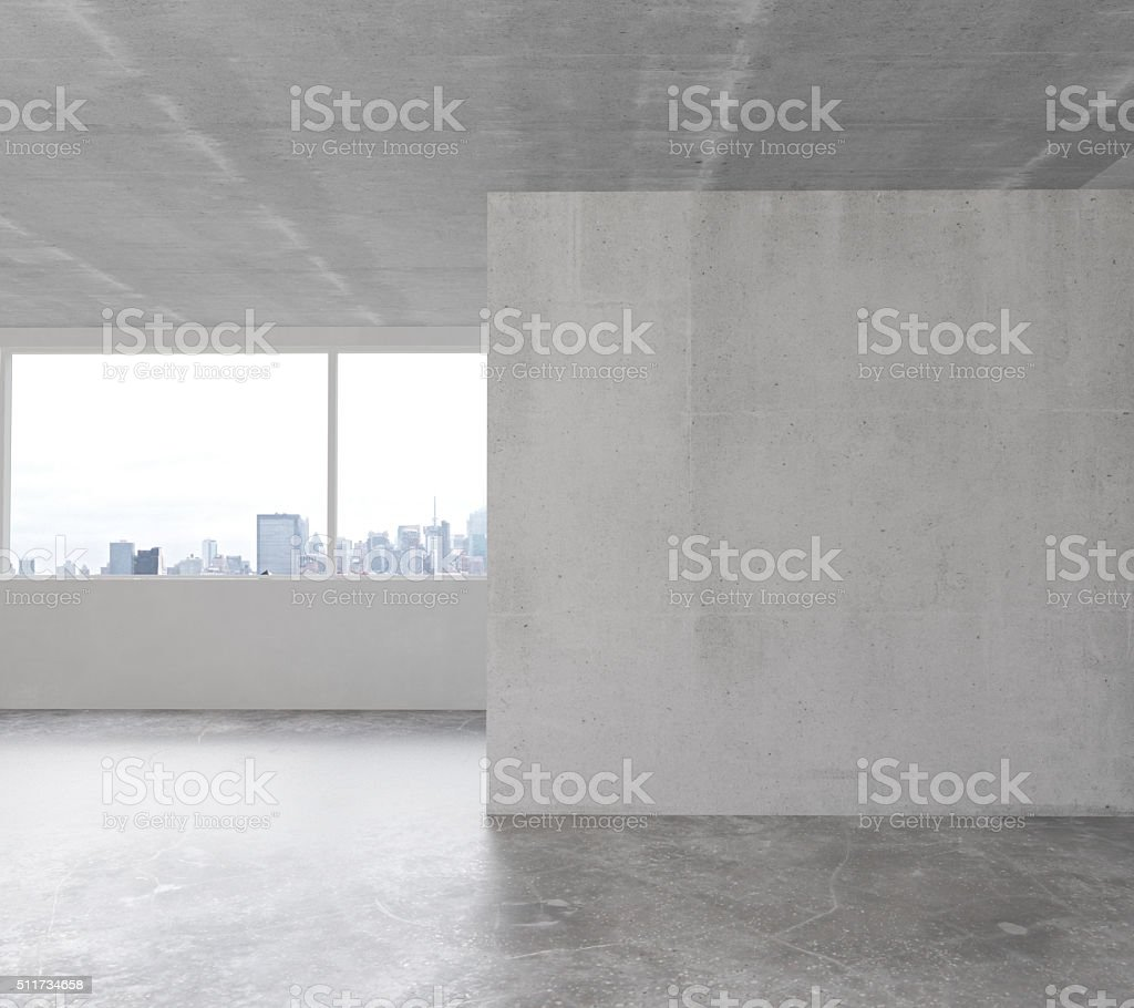 White wall in empty loft room with concrete floor stock photo