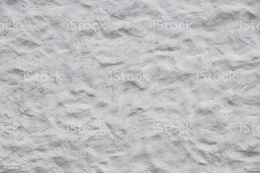 White wall of embossed decorative plaster royalty-free stock photo