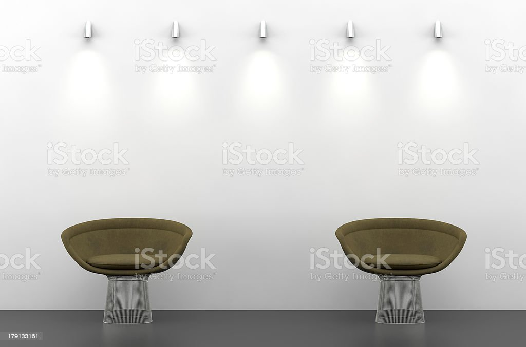 White wall with two brown chairs royalty-free stock photo