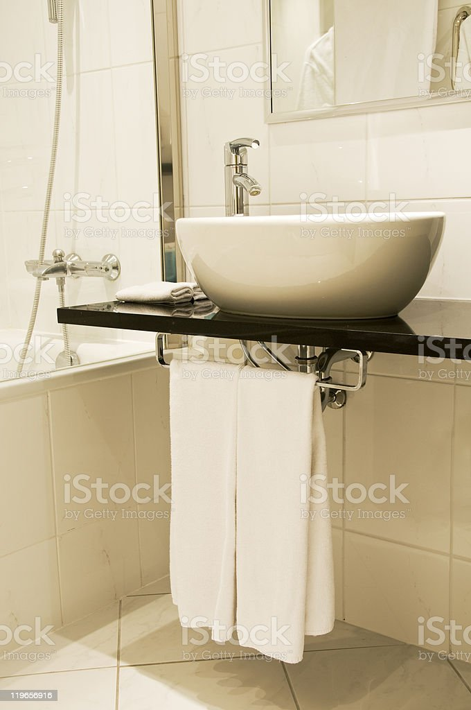 White washstand with towels stock photo