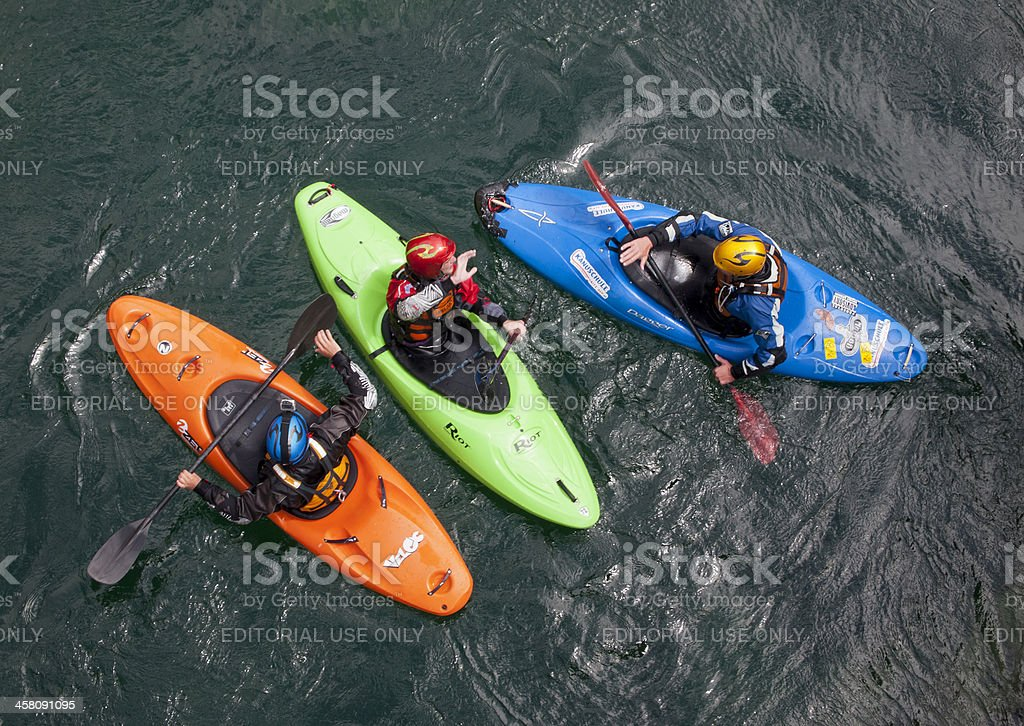 White water kayakers in colorful kayaks seen from top stock photo