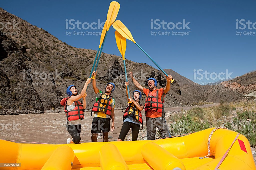 White water rafters raising oars royalty-free stock photo