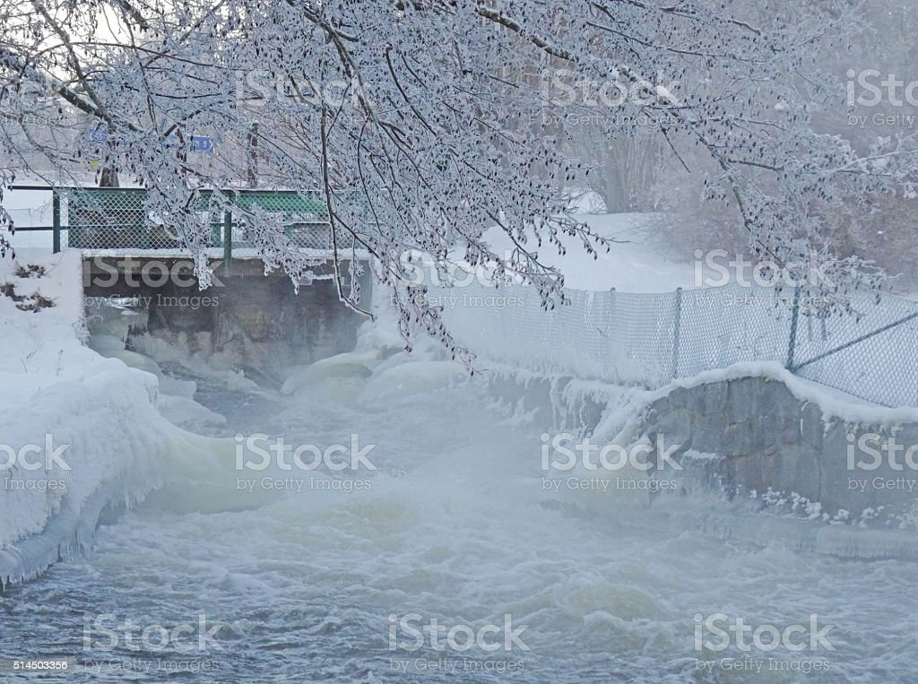 White water with ice formations in winter stock photo