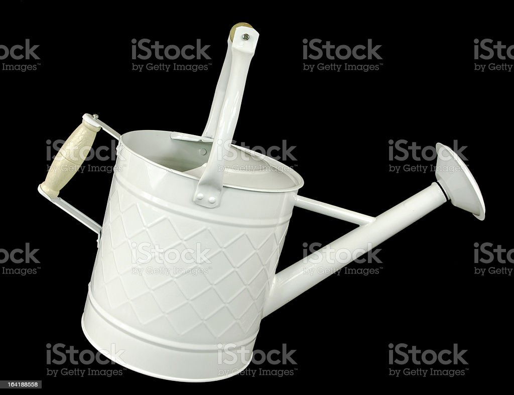 White Watering Can on Black royalty-free stock photo