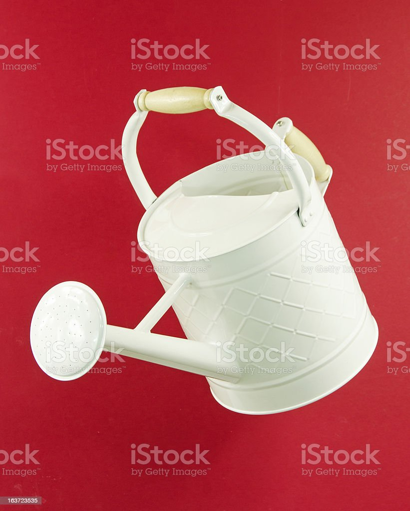 White Watering Can on Red royalty-free stock photo