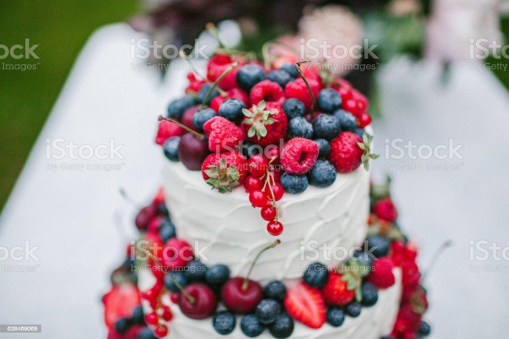 White wedding cake closeup with berries stock photo