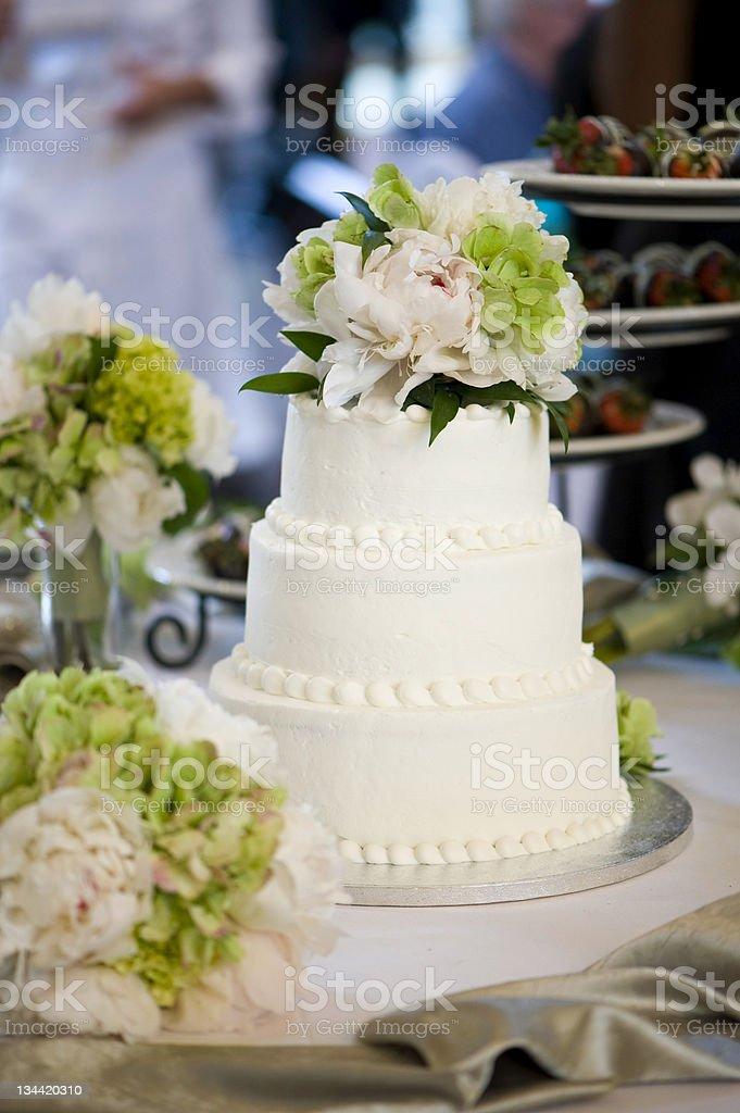 White Wedding Cake with Flowers royalty-free stock photo